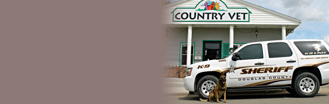 Sheriff's SUV & Police Dog sitting outside the entrance of Country Vet clinic | Caring for Our Communities Greatest Assets